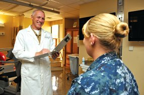 Naval Medical Center San Diego's Deputy Commander Capt. Mark Kobelja speaks with a patient. Kobelja says Congress and the Department of Defense have always taken military medical care seriously.