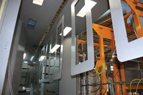 McCain Manufacturing's overhead I-Beam conveyor system has a 7-stage pretreatment wash, electrostatic application and curing process. The system features dual coating capabilities that can apply multiple coats of paint in half the time of previous processes.