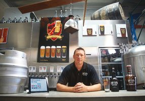 Mike Hess, owner of Hess Brewing, is in his tasting room at the microbrewery off Miramar Road in San Diego. Hess uses an Apple iPad with a specialized attachment and software from Square Inc. that serves as a cash register. Patrons pay with a credit card, Hess swipes the card through the attachment seen on the left side of the iPad and the customer signs the iPad screen.