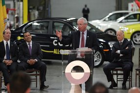 From left, Mayor Antonio Villaraigosa and Gov. Jerry Brown flank CEO Phil Murtaugh at the 2011 opening of Codas L.A. headquarters.