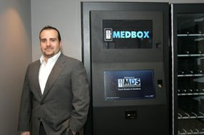 Medbox's Pejman Vincent Mehdizadeh with pot-dispensing machine in 2012.