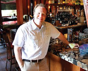 Simms: founder with cucumber mint martini at Orange restaurant