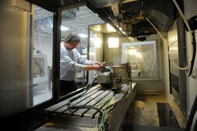 A NuVasive Manufacturing LLC employee works at San Diego-based NuVasive Inc.'s plant in Dayton, Ohio.