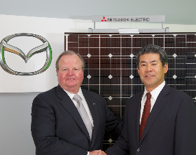 Jim O'Sullivan, president and chief executive at Mazda North American Operations, and Katsuya Takamiya, president and chief executive at Mitsubishi Electric U.S. Inc.