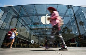 High Tech, High Price: Passers-by in front of the Apple store on the Third Street Promenade in Santa Monica.