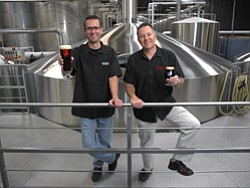 Steve Wagner, right, and Greg Koch, co-founders of Stone Brewing in Escondido, say increasing sales of their craft beers prompted purchase of a new $6.2 million, 60,000-square-foot distribution warehouse. To read the story, please turn to Page 4.