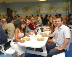 "Workers in Irvine-based Arbitech LLC's Laguna Beach-themed cafeteria: they eat family-style at picnic tables to foster ""sense of community and family,"" President Josh McCarter says"