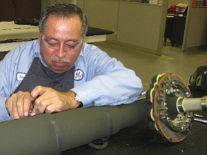 GE technician working on landing gear: unit diversifying work