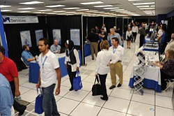 Visitors browse the aisles at the recent AIS technology  expo.