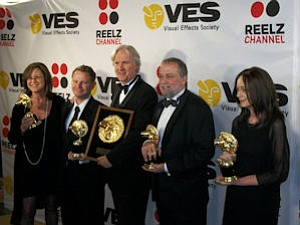 "Director James Cameron (center) with some of the visual effects team for ""Avatar"" at the 8th annual Visual Effects Society Awards."