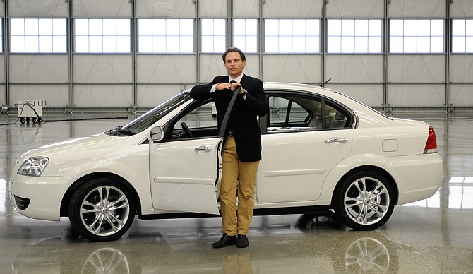 Coda Chief Executive Kevin Czinger with the company's electric sedan.