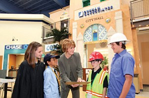 Joanne Pastula, president and CEO of Junior Achievement of San Diego and Imperial Counties, center, guides the 60-year-old nonprofit's efforts in educating youths about practical business and financial matters.