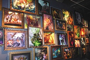 Framed Blizzard art at Irvine headquarters: collection includes paintings, sculptures, clay models, napkin sketches