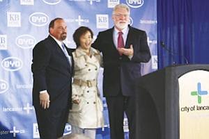 Partners: KB Homes' Tom DiPrima, left, Stella Li of BYD and Lancaster Mayor R. Rex Parris.