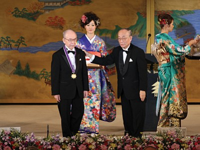 Isamu Akasaki, left, receives his Kyoto Prize during November ceremonies in Kyoto.