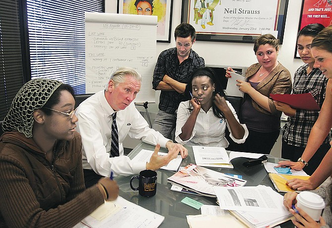 Levine, second from left, discusses e-newsletter with staffers.