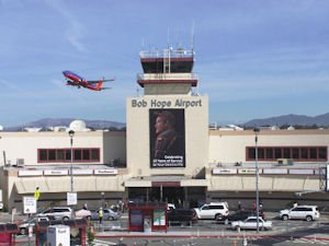 Airport: Image of Bob Hope on 80th anniversary banner.