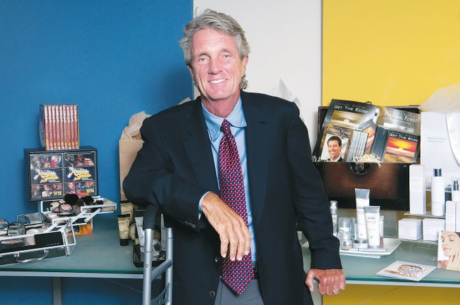 Greg Renker with some featured products at the infomercial production company in Santa Monica.