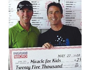 Greg Spierkel, Ingram Micro chief executive, left, Curtis Green of Miracles for Kids: Ingram gave $25,000 to group