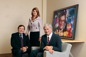 The legacy of the late Bill Otterson, in portrait at right, still looms large over Connect. Leading the organization today are, from left, David Hale, chairman; Camille Sobrian, chief operating officer; and Duane Roth, chief executive officer.