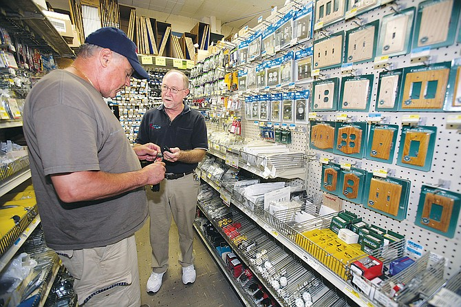Chip Kurzeka, at right, helps customer at his Franklin's Hardware in Woodland Hills.