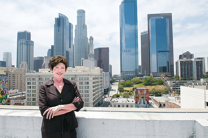 Community Redevelopment Agency CEO Christine Essel in front of the downtown skyline.