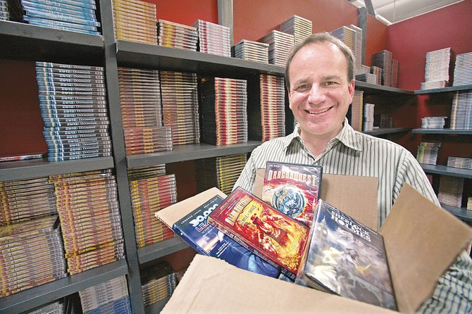 Paul Bales with some of the company's DVD titles at Burbank headquarters.