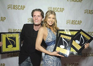 Music: Toby Gad (left) with Fergie.