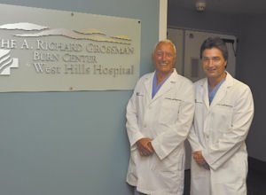 Team: Founder A. Richard Grossman and his son, Peter, inside the new burn center at West Hills Hospital.
