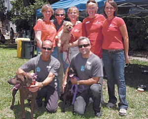 Event: Warner Bros. and shelter workers at a recent pet adoption event for studio employees on the company's lot in Burbank.