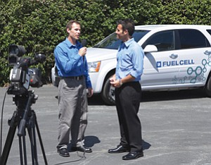 Simon Smith, left, interviews Shad Balch of General Motors for a video segment on HandBookLive. Smith is HandBookLive's president.