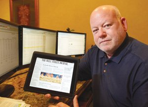 An iPad gives Donovan's Steakhouse owner Dan Shea the flexibility to read newspapers or PDF-format documents and work with spreadsheets while dividing his time among three offices.