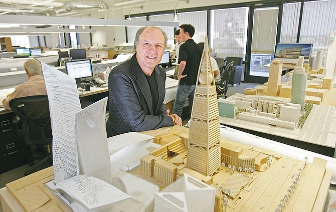Nadel Architects Chief Exec Herb Nadel at the firm's West L.A. office with a model of a building project.