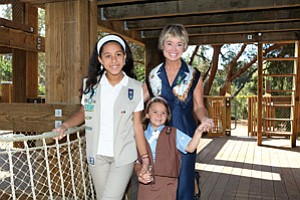 Girl Scouts San Diego CEO Jo Dee C. Jacob spends time with Scouts Makayla Soto, left, and Maria Burritt at the organization's Groce Family Tree House in Balboa Park.
