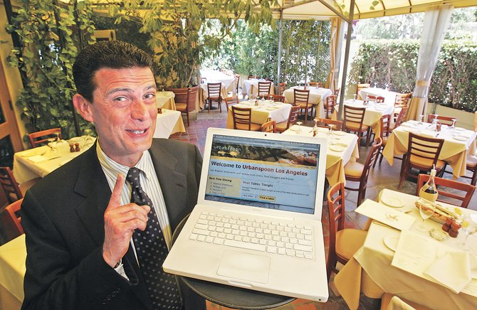Stefano Carella, Ago general manager, at the West Hollywood eatery, demonstrating Urbanspoon.