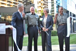 From left, Doug Holte of Irvine Co., Rory Moore of CommNexus, City Councilwoman Sherri Lightner, and Walter Davis, a retired Navy vice admiral and member of CommNexus' board of directors, cut the ribbon at the EvoNexus technology incubator in the University Towne Center area.