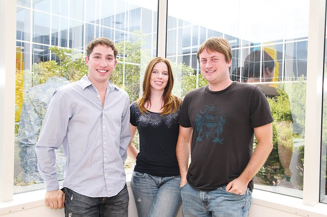 From left, Meteor's Zac Brandenberg, and Donna and Adam Powell.