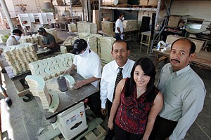 From left, Cesar, Xochitl and Manuel Cortez at Celco Manufacturing's facility in East Los Angeles.