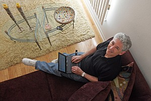 Alan Mendelson, who worked as a reporter on KCAL (Channel 9) from 1990 to 2006, on the couch at his townhome in West Los Angeles.