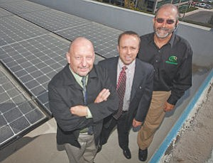 Team: Green Convergence President Donald Schramm, left, Ken Raleigh of Hedman Partners and Green Convergence CEO Mark Figearo at a solar project.