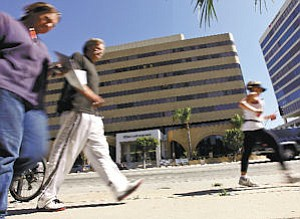 Business: Pedestrians walk down Ventura Boulevard, which is lined with banks.