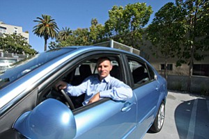 Kevin Czinger, chief executive of electric-car maker Coda Automotive, in one of the company's Sedans at Coda's Santa Monica office.