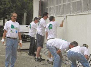 Paint: CB Richard Ellis associates do work at transitional living center.