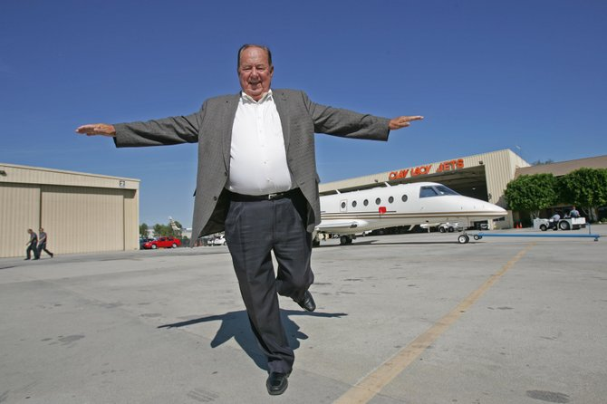 Clay Lacy, founder and chief executive of Clay Lacy Aviation, near one of the jet charter company's aircraft at Van Nuys Airport.