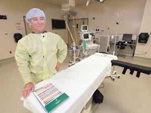 CEO: Robert Trautman  shows off  an operating room at the new hospital.