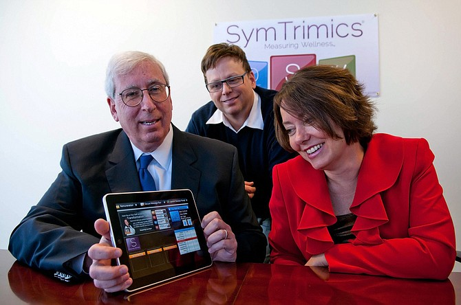 From left, Bruck, Owens and Senholz with Symtrimics' iPad program.