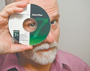 Software: Life Sciences Director Dr. Robert Clark with a copy of the bestselling GastroPlus.