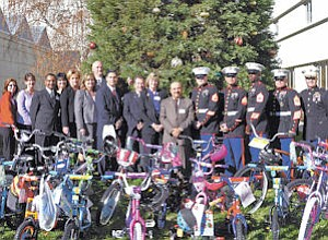 Antelope Valley Hospital employees gave bikes to the Marines' toy drive program.