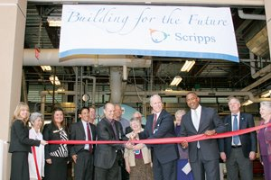 Chris Van Gorder, Scripps Health's president and CEO who is shown cutting the ribbon, joins guests in celebrating the opening of Scripps Mercy Hospital's central energy plant.