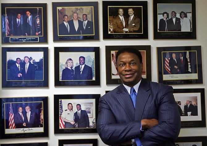 Gene Hale, chief executive of G&C Equipment Corp., with photos at his Gardena office showing him with presidents and other political figures.